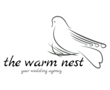 the Warm Nest Logaster logo
